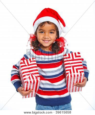 Little girl in Santa's hat with gift box