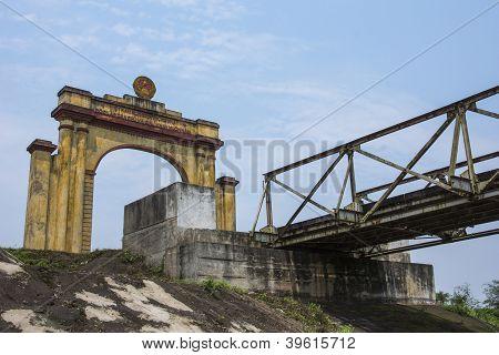 Vietnam Dmz - Triumphal Arch On North Vietnamese Side Of Bridge Crossing River.
