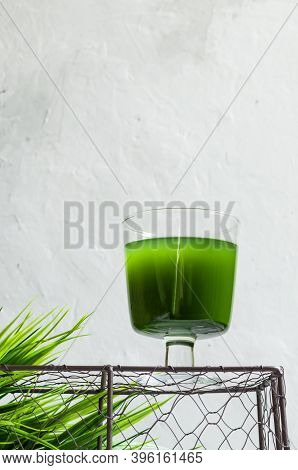 Chlorella Detox Healthy Drink In Glass On An Openwork Podium On A Light Background. Superfood, Natur