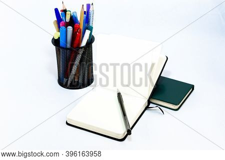 Pen Lie On Black Open Small Unfold Notebook, Note With Blank Empty Light Pages Near Metallic Glass S