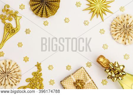 Festive Background With Gold Decoration , Gift Box With Bottle Of Sparkling Wine, Shiny Golden Serpe