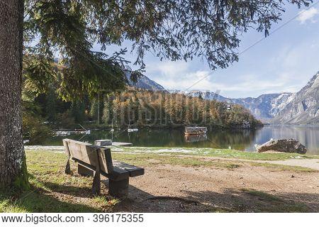 Bench Near Picturesque Lake Bohinj In The Triglav National Park In Slovenia. Julian Alps Mountain Ra