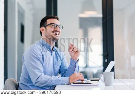 Young Smiling Cheerful Confident Businessman Entrepreneur Talking To Satisfied Customer Or To Collea