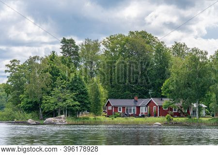 View On Red Holiday Cabin By A Lake In Stockholm Archipelago, Sweden