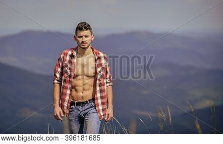 Nature Lover. Sexy Macho Man In Checkered Shirt. Cowboy In Hat Outdoor. Countryside Concept. Farmer