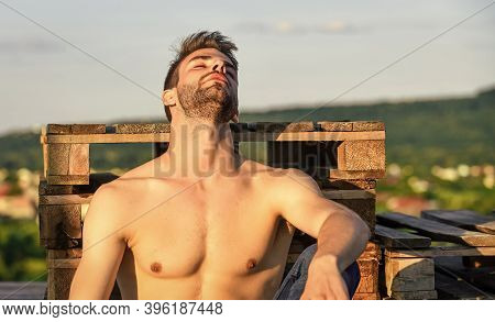 Summer Season. Fitness Model. Sexy Pensive Man Relaxing Outdoors. Male Beauty. Fashion Guy. Attracti