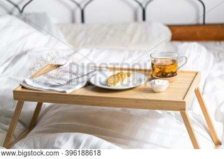 Yellow Cottage Cheese Pancakes On The Bed Tray Table With Black Tea And Sour Cream And Napkin In The