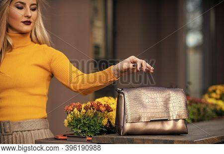 The Future Of Fashion. Gold Handbag For Woman, Selective Focus. Luxury Leather Purse. Sale Of Style.