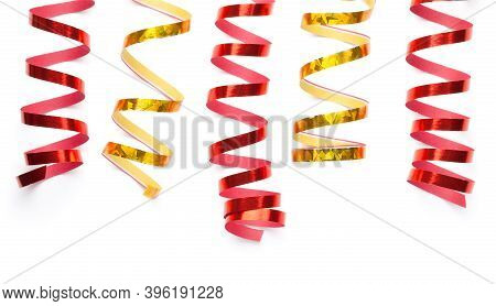 Red And Gold Serpentines Isolated Over White Background. Top View