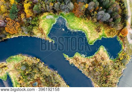 Abstract Autumn Landscape. River With Autumn Vibrant Riverbanks From Above. Fall Background.