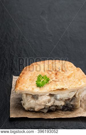 Homemade  Flaky Pasty With Chicken And Mushroom Filling On Black Stone Table