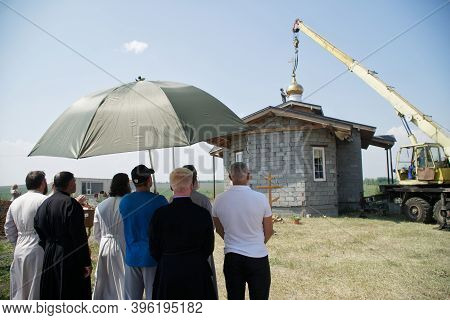 July 11, 2020, Russia, Magnitogorsk. A Church Delegation Of Priests Hides From The Sun Under A Large