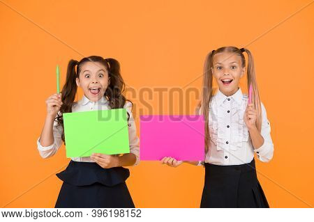 Genius School Tips. Small Pupils Got Ideas. Small Girls Holding Pens And Paper On Yellow Background.