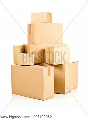 Stack Or Heap Of Brown Carton Cardboard Boxes Over White Background, Freight, Deilvery Or Shipping C