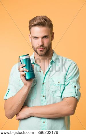 Man Confident Face Recommends Shampoo, Yellow Background. Guy With Bristle Holds Bottle Of Shampoo,