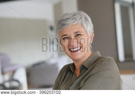 Portrait of a attractive mature woman with white hair