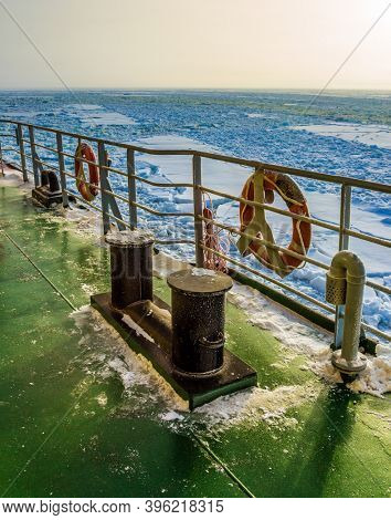 Lapland. The excursion to the arctic tourist cruise on the sea icebound. The concept of active and extreme tourism. The strip of ice crumb spreads behind the icebreaker