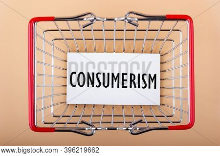 Inscription Consumerism On White Paper In A Shopping Basket. Consumerism Concept.