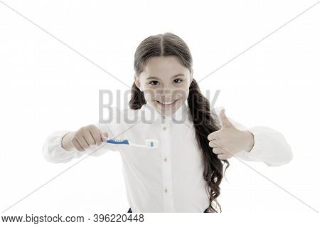 Girl Brilliant Perfect Smile Holds Toothbrush With Drop Of Paste White Background. Child Holds Tooth