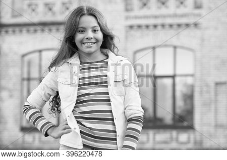 Peaceful Mood. Her Friendly Smile. Happy Childrens Day. Small Girl Has Curly Hair. Spring Kid Fashio