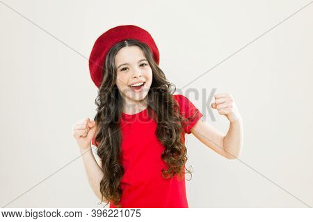 Little Girl In French Style Hat. Happy Girl With Long Curly Hair In Beret. Summer Fashion And Beauty