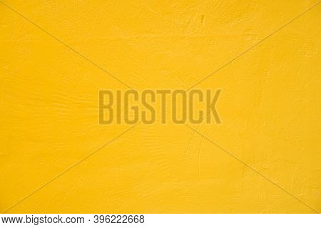 Close-up Photos Of Yellow Concrete Texture Details Background. House, Shop, Cafe And Office Design B