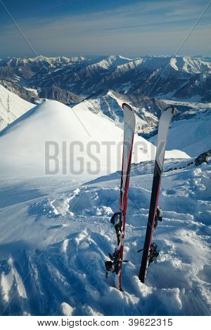 Pair of cross skis in snow,  in the mountains poster