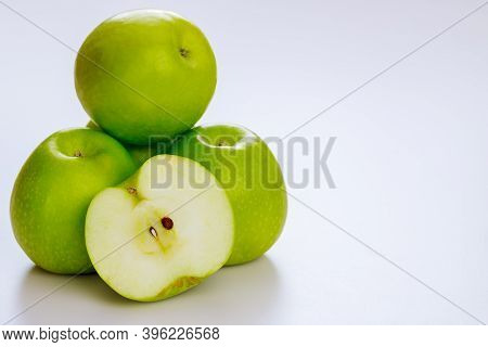 Green Apples And Isolated On White Background. Produce Product.