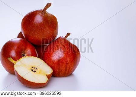 Red Juicy Pears Isolated On White Background. Produce Product.