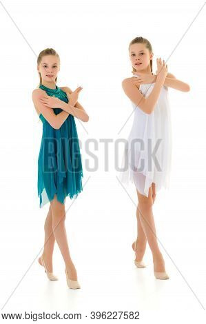 Pretty Gymnasts Performing Rhythmic Gymnastics Exercise, Two Beautiful Teen Sisters Dancing Wearing