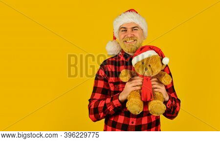 Charity Project. Bearded Man Celebrate Christmas. Kind Hipster With Teddy Bear. Charity And Kindness
