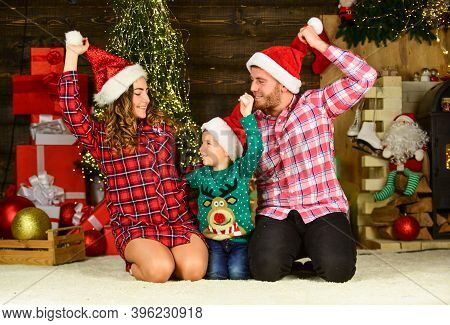 Parenthood Happiness. Family Values. Spend Time With Family. Parents Child Waiting For Santa. Winter