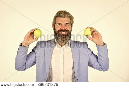 Cheerful Smiling Man With Apples. Vitamin And Diet. Fruit Harvest. Successful Businessman Holding An
