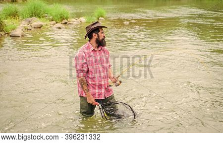 Summer Weekend. Big Game Fishing. Fisherman With Fishing Rod. Bearded Fisher In Water. Hobby And Spo