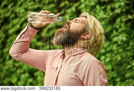 Another Sip. Handsome Man Drinking Fresh Water From Bottle. Morning Routine. Daily Intake Of Water.