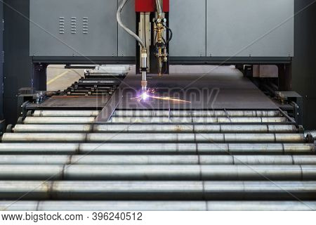 Industrial cnc plasma machine cutting of metal plate and profile
