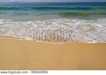 Empty Wavy Beach On The Beautiful Sunny Day
