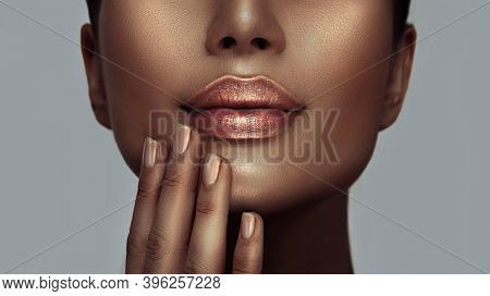 Beauty woman face closeup, lips and nails close-up, beautiful African American model girl's mouth, healthy skin. Make-up. Beauty woman makeup