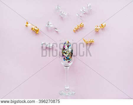 Champagne Glasses With Confetti And Serpentine On A Pink Background. Flat Lay, Top View Celebrate Pa