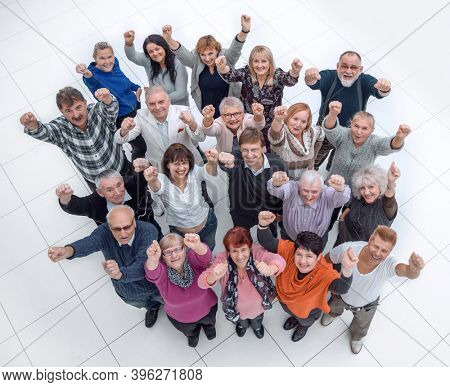 group of confident mature people showing their success
