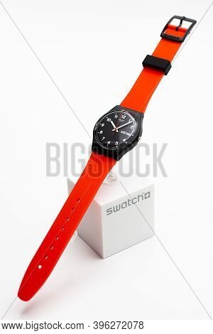 Rome, Italy 07.10.2020 - Swatch Fashion Swiss Made Quartz Watch Isolated On Brand Stand. Black Plast