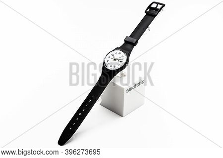 Rome, Italy 07.10.2020 - Swatch Simple Fashion Swiss Made Quartz Watch Isolated On White. Black Plas