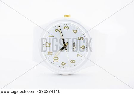 London, Gb 07.10.2020 - Swatch Simple Design Swiss Made Mechanical Watch Close Up. Plastic Case Styl