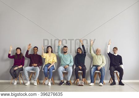 Group Of Happy Diverse People Raising Hands Unanimously Voting For Suggested Idea