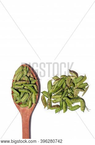 Grass Pea Seeds Or Chickling Vetch In Wooden Ladle Isolated On White Background, Also Known As Lathy