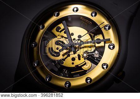 London, Gb 07.10.2020 - Swatch Swiss Made Quartz Watch On Black Backdrop. Plastic Case Open Clock Me