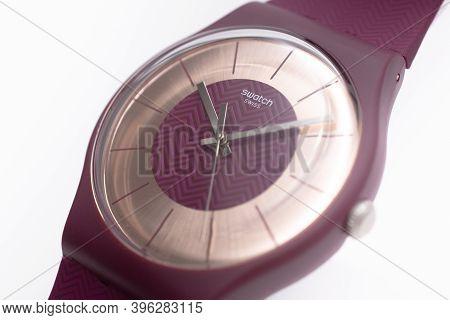 Geneve, Switzerland 07.10.2020 - Swatch Swiss Logo On Cherry Wristwatch Dial Of Swiss Made Quartz Wa