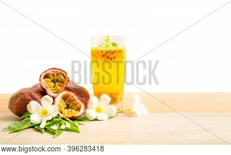 A Glass Of Passionfruit Juice With Mint And Group Of Purple Skin Passionfruit Plant, Sliced And Roun