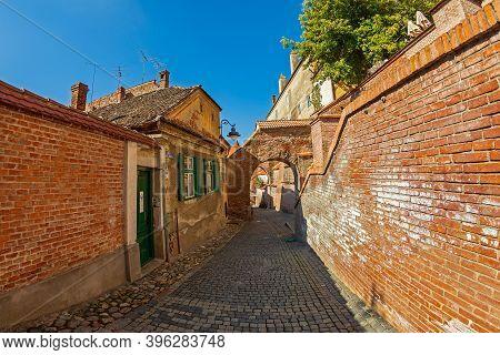 Sibiu, Transylvania, Romania - July 8, 2020: Stairs Passage, Known As The Needle Wall, A Stone And B