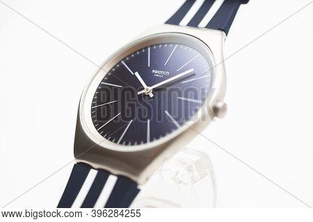 Rome, Italy 07.10.2020 - Swatch Simple Classic Sport Design Swiss Made Quartz Watch Close Up. Metal